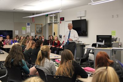 Justice David Lillehaug speaking to a class at Alexandria Area High School